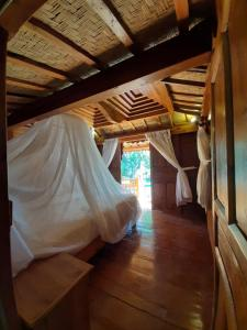 A bed or beds in a room at Hibiscus House Pemuteran Bali