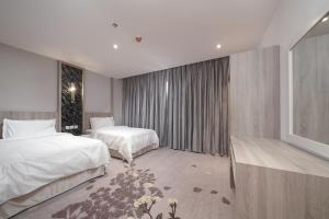 Cama ou camas em um quarto em Swiss In Park Tabuk
