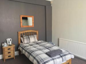 A bed or beds in a room at Bourton House
