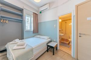 A bed or beds in a room at Phaedra Hotel