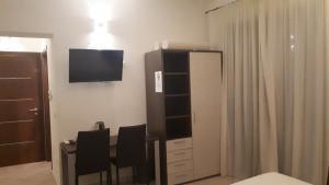 TV o dispositivi per l'intrattenimento presso Domo - Guest-House Il Nespolo Fiorito