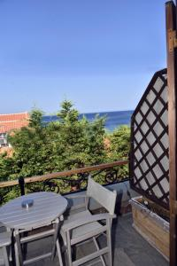 A balcony or terrace at Olive Press Hotel & Apartments