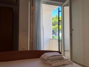 Posteľ alebo postele v izbe v ubytovaní Adriatic House