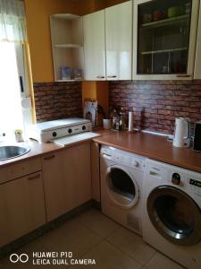 A kitchen or kitchenette at Albergue Por Fin