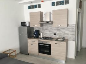 A kitchen or kitchenette at B&B Le Meduse