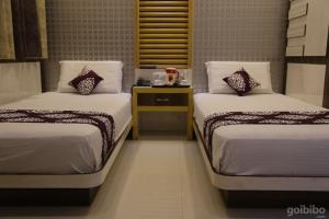 A bed or beds in a room at Comfortable Stay in Ajmer