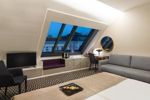 A seating area at Hotel Moments Budapest