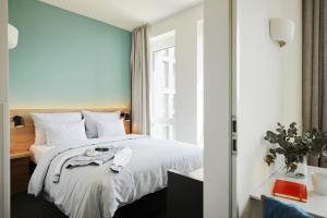 Ein Bett oder Betten in einem Zimmer der Unterkunft sylc. Apartmenthotel – Serviced Apartments