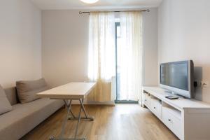 Телевизор и/или развлекательный центр в Apartment Otrada