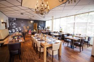A restaurant or other place to eat at Amrâth Hotel Media Park Hilversum