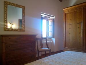 A bed or beds in a room at Agriturismo Bonacchi