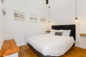 A bed or beds in a room at By The Seaside