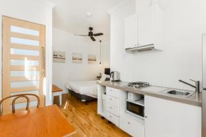 A kitchen or kitchenette at By The Seaside