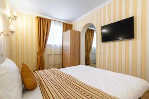 Кровать или кровати в номере Мини-Отель ГРК Горки 10
