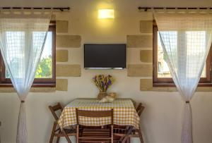 A television and/or entertainment center at The Carob Tree Cottage