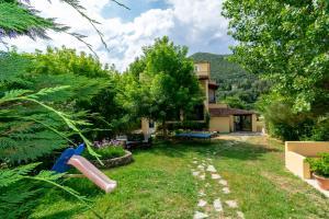 A garden outside Villa Litsa