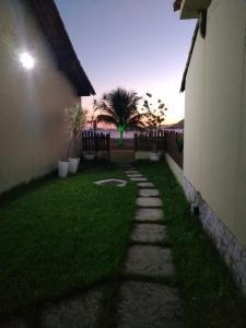 A garden outside Suíte 101- Espaço Praia Aptos