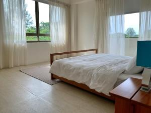 A bed or beds in a room at By The Sea Suites - Managed by SDB Host