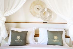 Uma cama ou camas num quarto em Sunhouse, Mandala Village