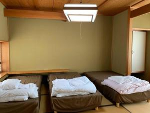 A bed or beds in a room at ZEN Hostel