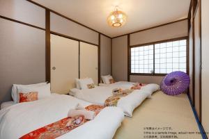 Stay SAKURA 京都東寺町屋にあるベッド