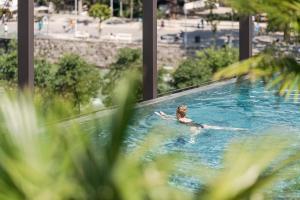 The swimming pool at or near Hotel Therme Meran - Terme Merano