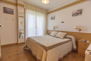 Cama o camas de una habitación en Hotel La Casa Del Abuelo