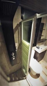 A bathroom at Perneia Rooms