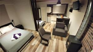 A television and/or entertainment center at Perneia Rooms