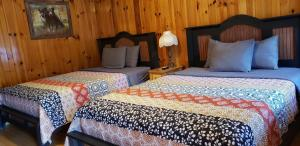A bed or beds in a room at Marshall's Creek Rest Motel