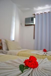 A bed or beds in a room at Residencial Mont Sinai - Tonziro