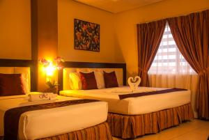 A bed or beds in a room at Hotel Nicanor