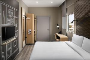 Cama ou camas em um quarto em Ibis Jeddah Malik Road