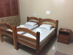 Cama ou camas em um quarto em Kitenet estúdio Cumbuco