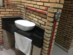 Um banheiro em Kitenet estúdio Cumbuco
