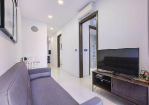 A television and/or entertainment center at 2br Raffles Executive
