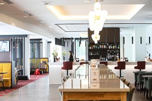 A restaurant or other place to eat at Hampton By Hilton Toulouse Airport