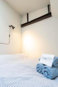 Cama o camas de una habitación en B&B Vita Nova