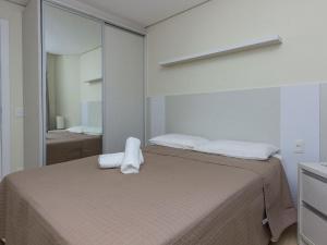 Cama ou camas em um quarto em Portofino