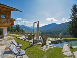 The swimming pool at or close to Chalet Piz da Peres