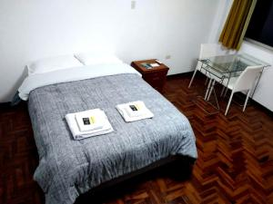 A bed or beds in a room at Santa Victoria House