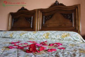 Letto o letti in una camera di Fattoria Delle Rose