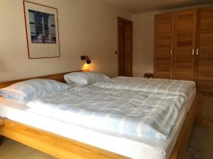 Ein Bett oder Betten in einem Zimmer der Unterkunft Apartment 2