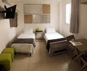 A bed or beds in a room at Pousada e Hostel Chez Marianne