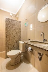 Um banheiro em Pousada Do Rio
