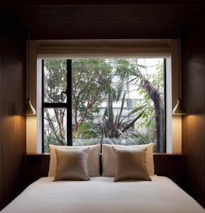 A bed or beds in a room at Hamacho Hotel Tokyo