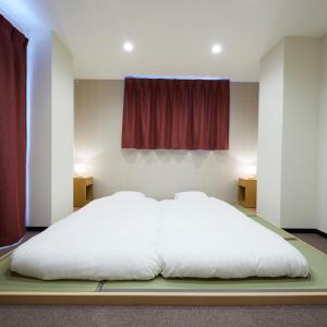 鈴七條大橋旅館房間的床