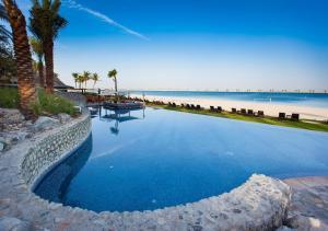 The swimming pool at or near JA Palm Tree Court (JA The Resort)