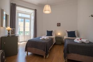 A bed or beds in a room at Dream View Apartment Lisbon