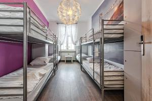 A bunk bed or bunk beds in a room at 3 City Hostel